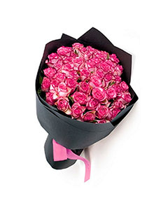 Bouquet of pink roses in kraft paper