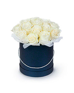 White Roses in a Round Black Box