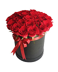 Roses in a Round Black Box