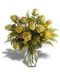 Dozen yellow roses in a glass vase