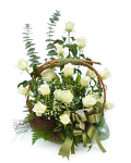 White roses arranged in a basket