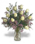 Dozen white roses in a glass vase