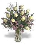 Dozen white roses in a glass vase