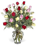 Two dozen mixed roses in a glass vase